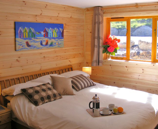 Image of a Kent Cabin Craft Centre log cabin being used as an extra room